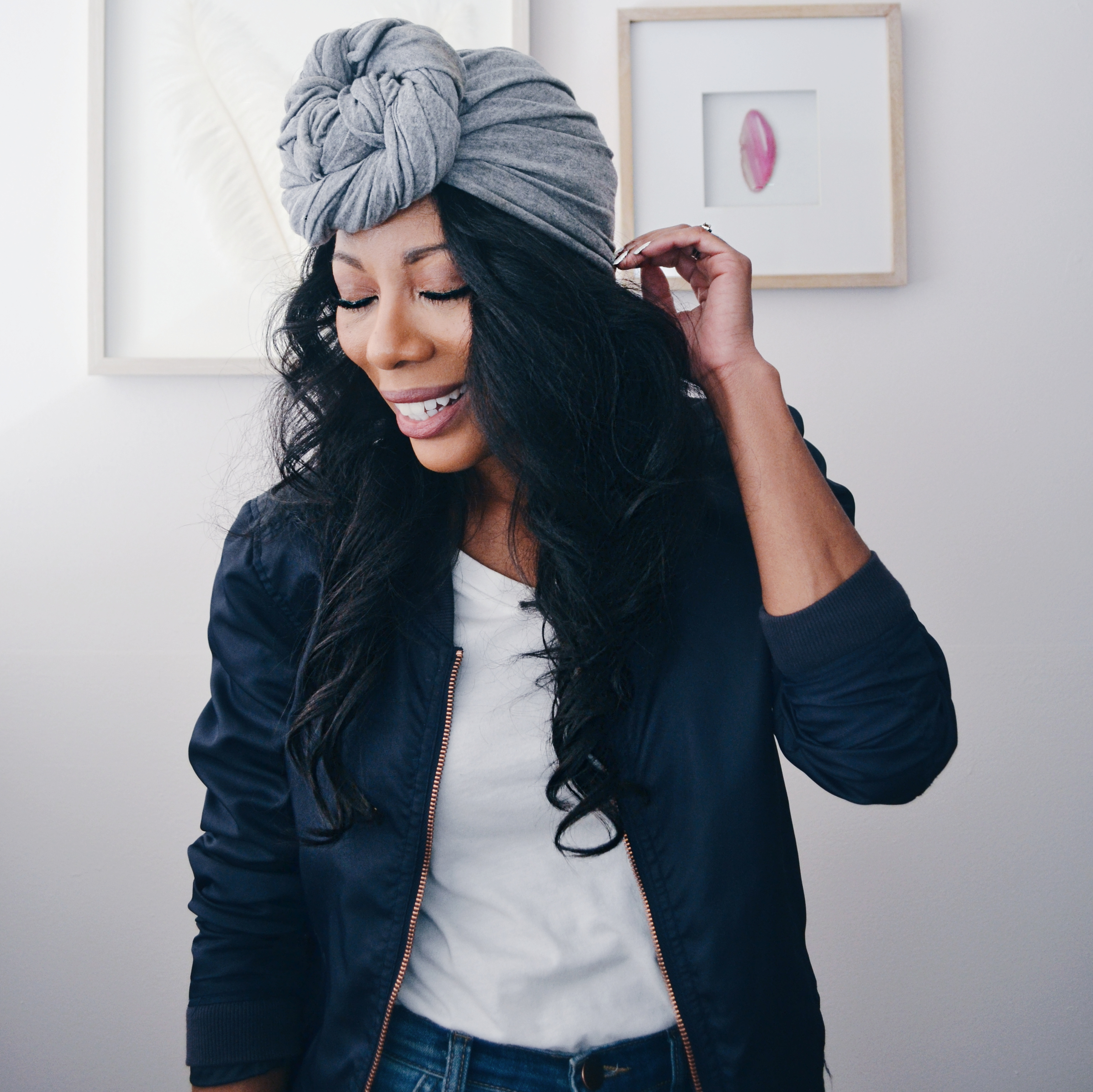 black woman head wrap smiling long hair