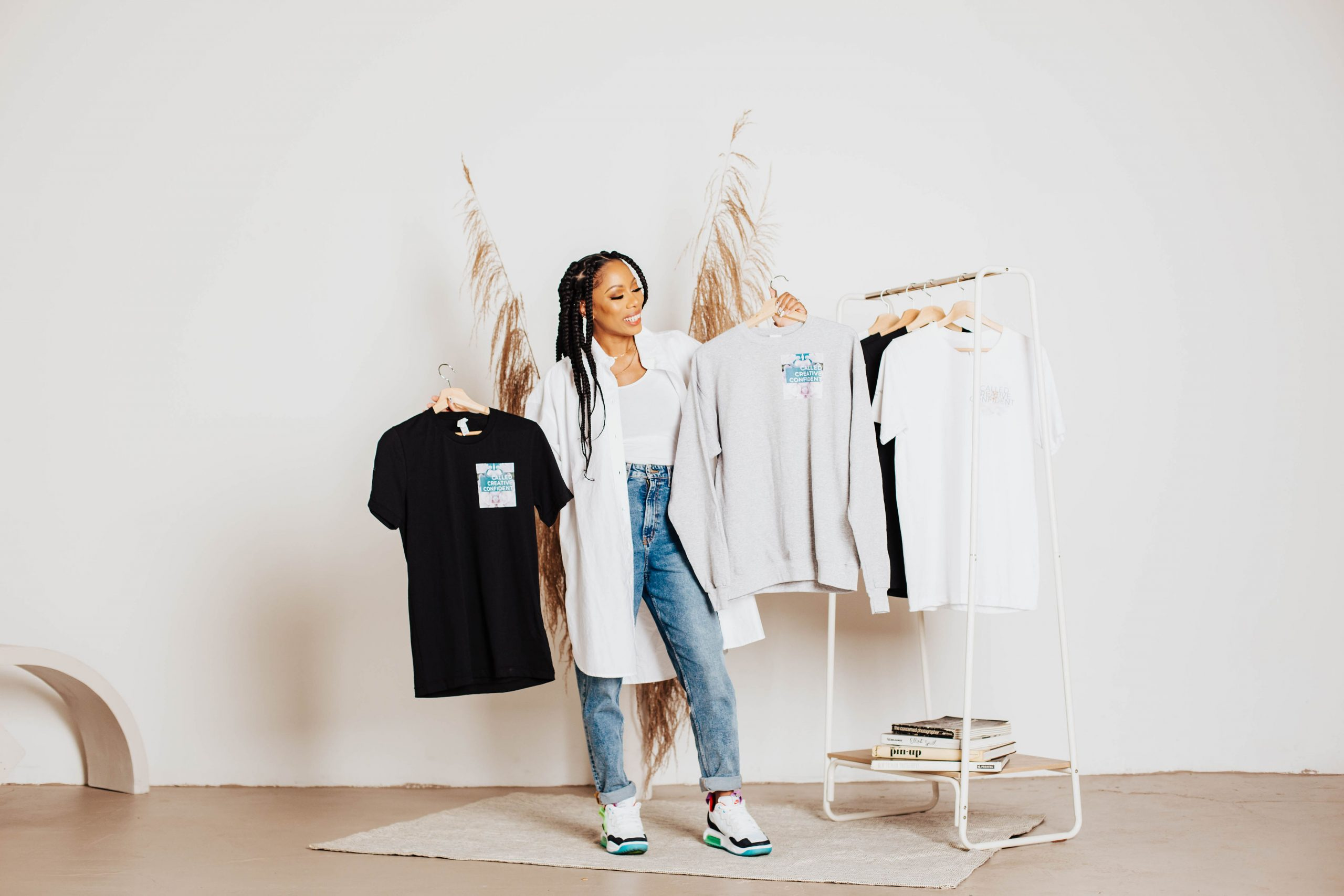faith and lifestyle brand owner with shirts